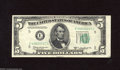 Error Notes:Skewed Reverse Printing, Fr. 1965-E $5 1950D Federal Reserve Note. Very Fine. This note ismisaligned on both the front and back showing numerous gu...