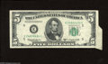 Error Notes:Attached Tabs, Fr. 1965-E $5 1950D Federal Reserve Note. Very Fine. A largeattached tab that exhibits five paper guide line markers is fou...
