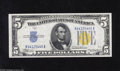 Error Notes:Ink Smears, Fr. 2307 $5 1934A North Africa Silver Certificate. Choice CrispUncirculated. The back reveals a light ink smear within the ...