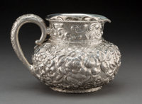 A Dominick & Haff Silver Floral Repoussé Water Pitcher, New York, New York, circa 1890 Marks: (cipher-925-189...