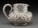 A Dominick & Haff Silver Floral Repoussé Water Pitcher, New York, New York, circa 1890 Marks: (cipher-925...