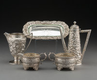 Five American Silver Floral Repoussé Table Articles, circa 1870 and later Makers including Gorham, M.W. Galt &...
