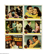 "They Met in Bombay (MGM, 1941). Lobby Cards (6) (11"" X 14""). Clark Gable and Rosalind Russell are competing je..."