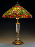 Art Glass:Other , Wilkinson Leaded Glass and Brass Magnolia Blossom TableLamp. Circa 1910. Base molded 900. Ht. 28-3/4 in. . PROP... (Total:2 Items)