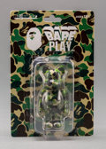 Fine Art - Sculpture, American:Contemporary (1950 to present), BE@RBRICK X BAPE. Camo 100% (Green), 2012. Painted cast vinyl. 6 x 4 x 1 inches (15.2 x 10.2 x 2.5 cm) (box). Stamped on...