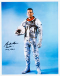 Autographs:Celebrities, Gordon Cooper Signed Silver Spacesuit Color Photo. ...