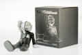 Collectible, KAWS (American, b. 1974). Companion (Resting Place) (Grey), 2013. Painted cast vinyl. 9-1/4 x 6-1/4 x 10-1/4 inches (23....