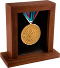 Olympic Collectibles:Autographs, 1988 Calgary Winter Olympics Sample Gold Medal.. ...