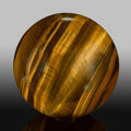 Lapidary Art:Eggs and Spheres, Tiger's-Eye Sphere. Stone Source: Northern Cape Province.South Africa. 3.25 inches (8.25 cm) in diameter. ...