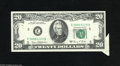 Error Notes:Attached Tabs, Fr. 2070-E $20 1969C Federal Reserve Note. About Uncirculated. ThisRichmond $20 acquired a center fold before its nice butt...
