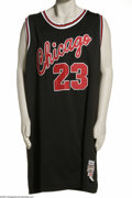 Basketball Collectibles:Others, Michael Jordan Signed UDA Jersey. His Airness applies his 10/10silver sharpie signature to the verso of an old school (198...