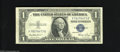 Error Notes:Skewed Reverse Printing, Fr. 1614 $1 1935E Silver Certificate. Very Fine. The back ismisaligned producing a cutting error showing a slice of the abo...