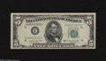 Error Notes:Skewed Reverse Printing, Fr. 1964-E $5 1950C Federal Reserve Note. Extremely Fine. The faceis nicely centered while the back is askew showing a pape...