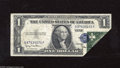 Error Notes:Foldovers, Fr. 1613N $1 1935D Silver Certificate. Very Fine. The lower rightcorner was folded over onto the face during the printing proce...