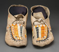 American Indian Art:Beadwork and Quillwork, A Pair of Rare Arikara Pictorial Quilled Hide Moccasins. c. 1885...(Total: 2 Items)