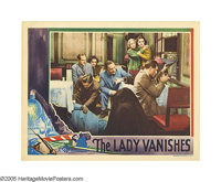 "The Lady Vanishes (Gaumont British, 1938). Lobby Card (11"" X 14""). Michael Redgrave shoots it out with an inte..."