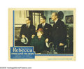 """Movie Posters:Hitchcock, Rebecca (United Artists, 1940). Lobby Card (11"""" X 14""""). LaurenceOlivier, Joan Fontaine and C. Aubrey Smith await the result..."""