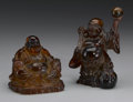 Asian:Chinese, PAIR OF CHINESE AMBERINE FIGURES. Pair of Chinese amberine figuresof Buddai; one standing and holding a scepter, with a s... (Total:2 )