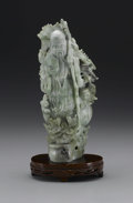 Asian:Chinese, CHINESE CARVED HARDSTONE FIGURE. Chinese carved hardstone figure ofa shoulao, holding a staff and peach and surrounded by...