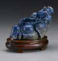 Asian:Chinese, CHINESE CARVED LAPIS LAZULI FIGURE. Chinese carved lapis lazulifigure of a reclining Buddai, with a large satchel and att...