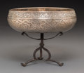 Decorative Arts, Continental, An Islamic Silvered Copper Bowl on Tripod Stand, circa 17thcentury. 2-3/4 x 7-3/4 inches (7.0 x 19.7 cm) (bowl, excluding s...(Total: 2 Items)