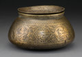 Decorative Arts, Continental, An Egyptian Engraved Brass Censer and Cover, 17th century or later.4-3/4 inches high x 8-1/4 inches diameter (12.1 x 21.0 c... (Total:2 Items)