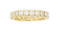 Estate Jewelry:Rings, Diamond, Gold Eternity Band The ring features ...