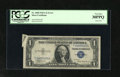 "Error Notes:Attached Tabs, Fr. 1608 $1 1935A Silver Certificate. PCGS Very Fine 30PPQ.. A widegutter produced the ""butterfly"" in the upper left corner..."