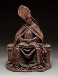 Decorative Arts, Continental, A Continental Carved Wood Ecclesiastical Figure of a Seated Bishop,18th century. 16-3/4 h x 12 w x 7-1/2 d inches (42.5 x 3...