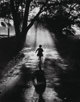 Gordon Converse (American, 1921-1999) Running to the Light, 1959 Gelatin silver 14 x 11 inches (35.6 x 27.9 cm) Date