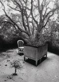 Photographs:Gelatin Silver, Jerry Uelsmann (American, b. 1934). Untitled (Desk andtrees), 1991. Gelatin silver. 19-1/2 x 15-3/8 inches (49.5 x39.1...