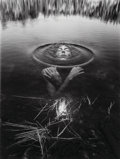 Photographs, Jerry Uelsmann (American, b. 1934). Untitled (Woman in lake), 1992. Gelatin silver. 19-3/8 x 14-5/8 inches (49.2 x 37.1 ...