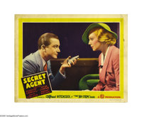 "Secret Agent (Gaumont, 1936). Lobby Card (11"" X 14""). Robert Young proudly displays his gun to co-star Madelei..."