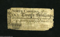 Colonial Notes:North Carolina, North Carolina March 9, 1754 20s Very Good. This Crown issue islegible, but is missing a few pieces....
