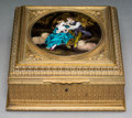 Decorative Arts, French, A Gilt Metal Table Box Inset with a Limoges Enameled Plaque, late19th century. 4-1/8 h x 9-3/4 w x 9-3/4 d inches (10.4 x 2...