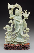 Other, A Chinese Carved Serpentine Guanyin Figure on Hardwood Base. 13-5/8 inches high (34.6 cm) (figure on base). 12-1/2 inches hi...