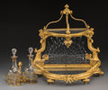 Decorative Arts, French, A Louis XVI-Style Gilt Bronze and Cut-Glass Tantalus, late 19th/early 20th century. 16-3/4 h x 17-1/2 w x 10-1/2 d inches (...(Total: 3 Items)