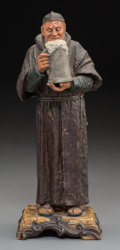 Ceramics & Porcelain, A Continental Painted Pottery Figure of a Monk, late 19th century. Marks: 4703, BB. 11 inches high (27.9 cm). ...