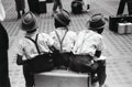 Photographs:Gelatin Silver, Ruth Orkin (American, 1921-1985). Three Boys on Suitcase,1948. Gelatin silver, printed later. 8-1/2 x 12-3/4 inches (21...