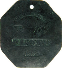1806 Charleston SERVANT Slave Hire Badge. Number 169. A slightly convex octagonal-shaped tag with a hole at the top for...