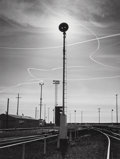 Photographs:Gelatin Silver, Ansel Adams (American, 1902-1984). Rails and Jet Trails,Roseville, California, 1953. Gelatin silver. 13-1/4 x 10inches...