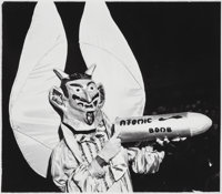 Weegee (American, 1899-1968) Devil with Atomic Bomb, 1940 Gelatin silver, printed later 9-3/8 x 1