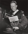 Photographs:Gelatin Silver, Weegee (American, 1899-1968). Los Angeles Salvation Army French Horn Player, circa 1940s. Gelatin silver. 9 x 7-3/8 inch...