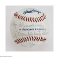 "Autographs:Baseballs, Negro League Stars Signed Baseball. Pristine white ""Negro League""ball offers strong blue ink autographs from Buck O'Neil, ..."
