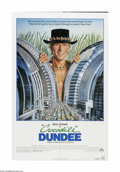 "Movie Posters:Adventure, Crocodile Dundee (Paramount, 1986). One Sheet (27"" X 41""). Offeredhere is a vintage, theater-used poster for this adventure..."