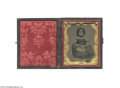 Antiques:Black Americana, A Vivid, Ninth Plate Cased Ambrotype of a Young Black Girl withRinglet Hair Holding a Book Surrounded by a brass mat, the p...