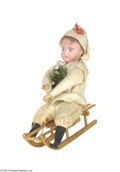 Antiques:Candy Containers, Boy on Sled with Tree Candy Container The container separates at the boy's waist to expose the secret cardboard candy holder...
