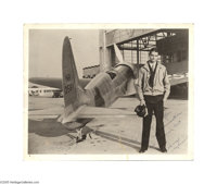 """Signed Photo of Howard Hughes Standing by His Plane The first modern and practical respirator was called the """"iron..."""
