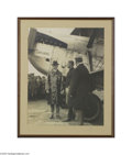 Transportation:Aviation, President Calvin Coolidge Original Photograph Wearing a raincoatand hat and standing next to a large plane, Coolidge is loo...