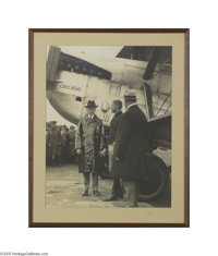 President Calvin Coolidge Original Photograph Wearing a raincoat and hat and standing next to a large plane, Coolidge is...